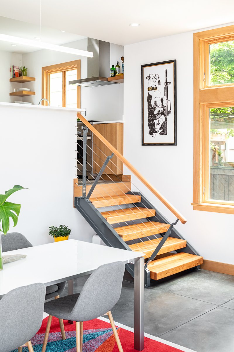 Dining Room, Concrete Floor, Chair, Recessed Lighting, Pendant Lighting, and Table Stairs from kitchen  Ballard Residence