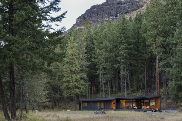 Nestled into the surrounding forest against a dramatic backdrop.
