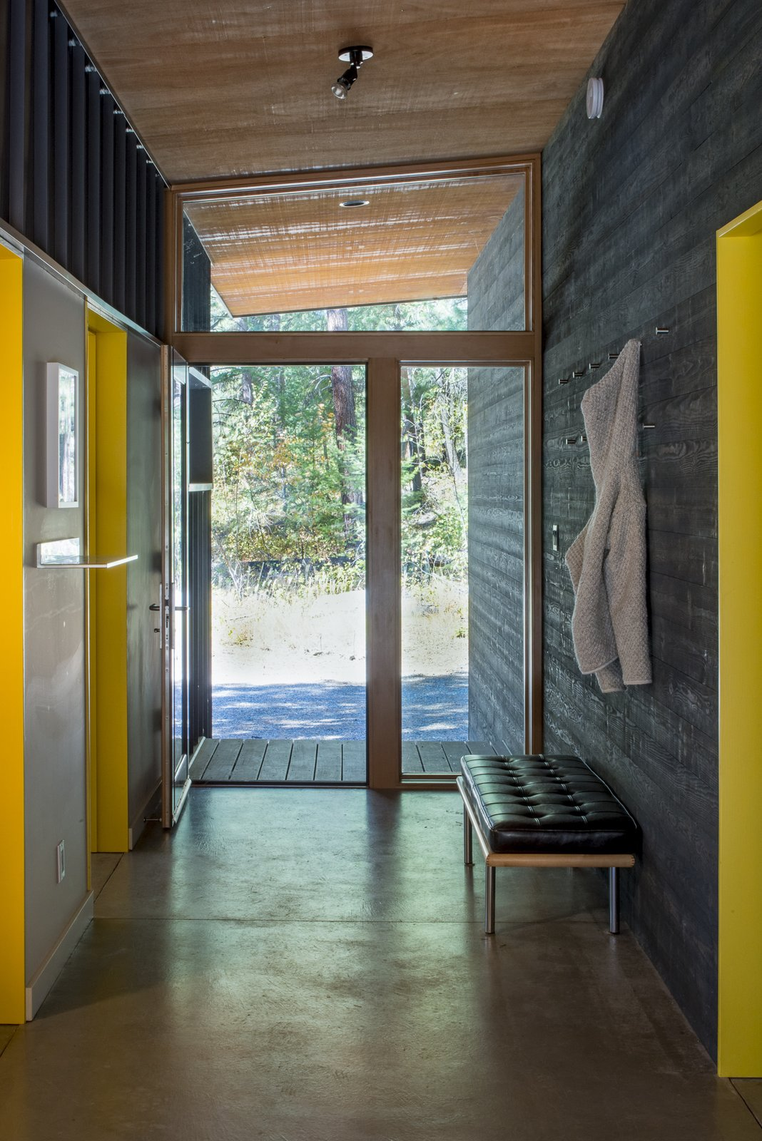 Hallway and Concrete Floor An entrance hallway is the first space you enter in a home, but it can also serve the very important function of acting as a drop-off station or mudroom for keys, shoes, and coats.  Lot 6 by Prentiss + Balance + Wickline Architects