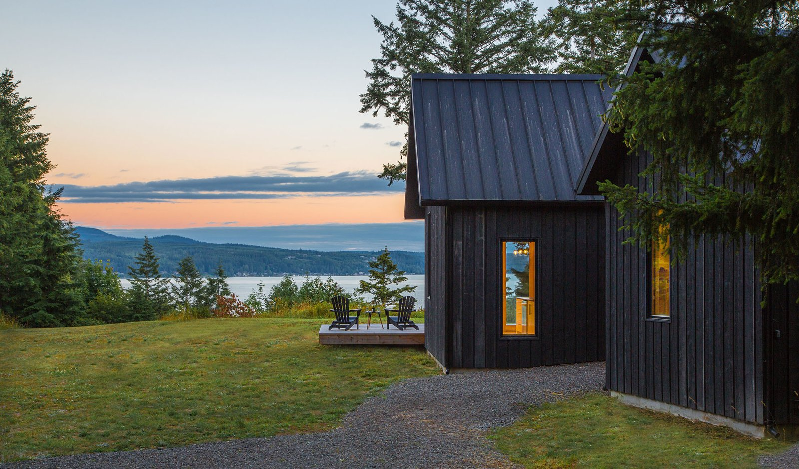 Outdoor Quiet, dark volumes emphasize the natural beauty and views of Hood Canal.  The Coyle by Prentiss + Balance + Wickline Architects