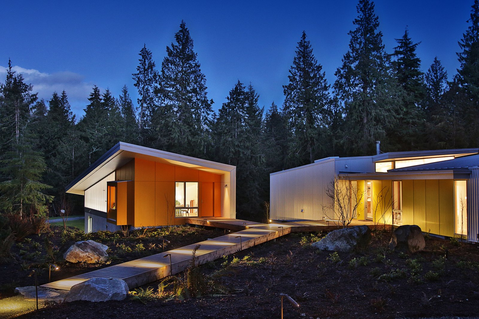 Exterior, House Building Type, and Metal Siding Material At night, the studios are lightboxes against the dark forest.  Whidbey Artists' Retreat by Prentiss + Balance + Wickline Architects