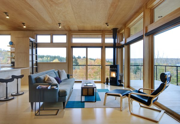 The cozy, birch plywood lined interior lets in views in all weather. The simple built-in ladder leads to a discreet hatch that opens for rooftop access.