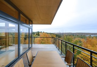 The expansive cantilevered decks let the clients enjoy the view they love from thirty feet above the ground.