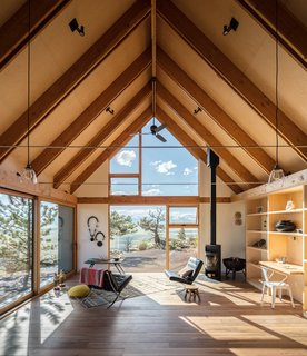 Designed to capture the character of traditional wooden cabins within a contemporary framework, this family residence in Fairplay, Colorado, is comprised of two volumes linked by an outdoor deck.
