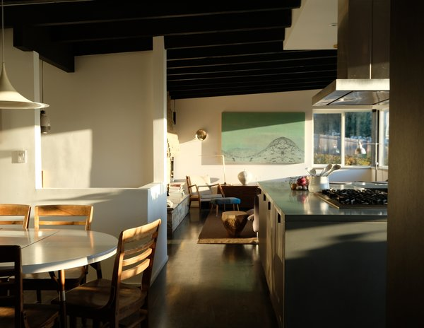 The dining and living areas of the Becker home are adjacent to the kitchen.