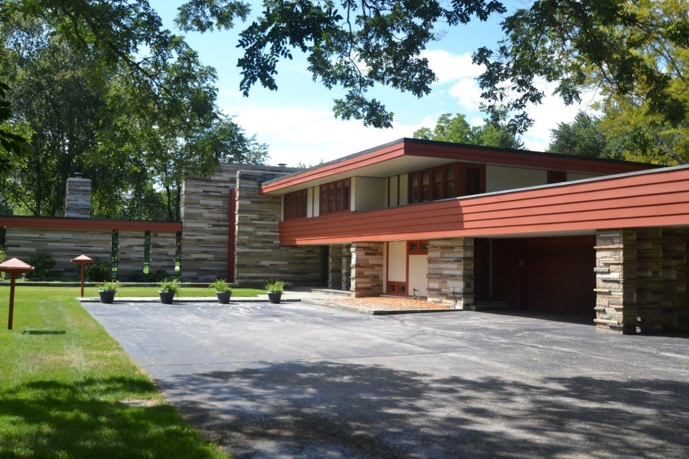 Glenn Beach's 1956 Gilbert Currie House is characteristic of the midcentury modern style with its streamlined, texture-rich exterior.  Photo 2 of 5 in Defining an Architectural Canon From the Ground Up