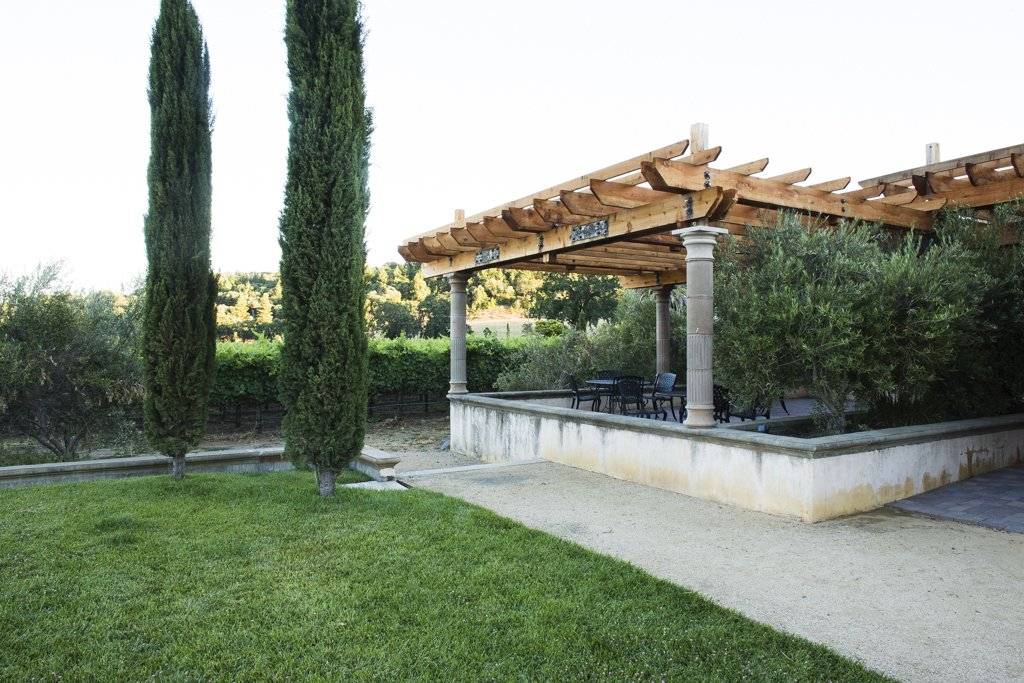 The larger pergola is outside of the winery's main tasting room, and provides a cool outdoor space for patrons.  Photo 2 of 6 in A Northern California Winery's Breathtaking Vistas Are Enhanced by Natural Redwood