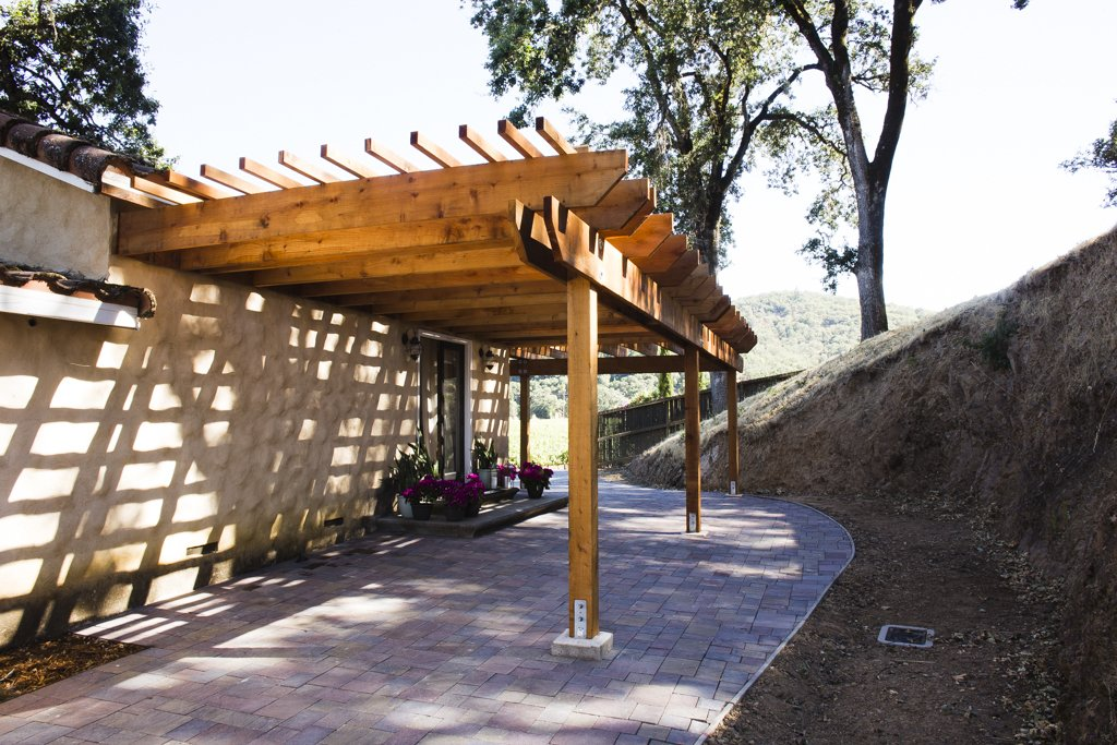 The second pergola shades the entryway to one guest casita, extending the private outdoor living space.  Photo 3 of 6 in A Northern California Winery's Breathtaking Vistas Are Enhanced by Natural Redwood