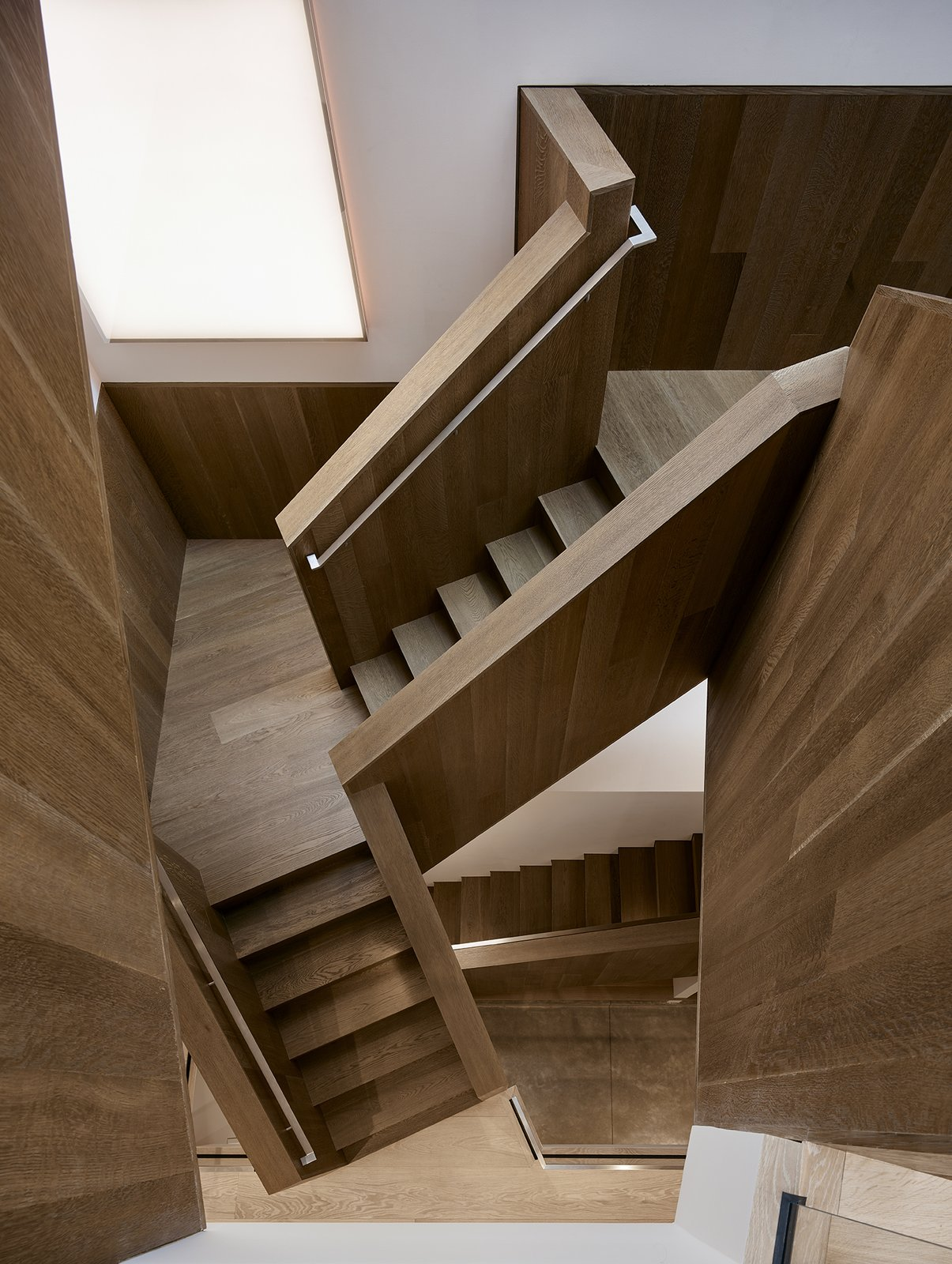 After: Alamo Square Residence geometric staircase with tread and railing made out of engineered oak