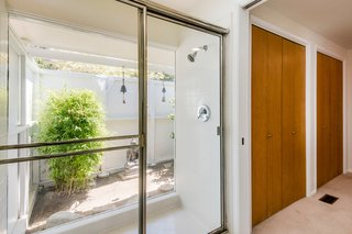 The indoor/outdoor shower is also original to the home.