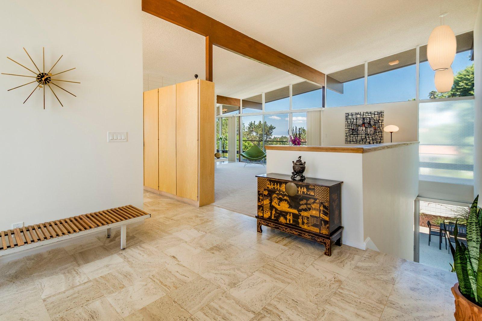 DeLeeuw Residence hallway with limestone tile floor.
