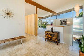 Original built-ins are a visual divider in the main floor living space.