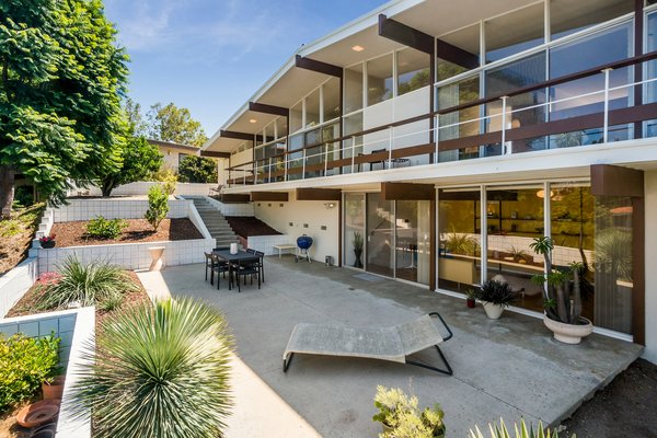 Drought-tolerant landscaping beautifies the backyard. The home's rear elevation features impressive spans of glass; original in appearance, but upgraded for energy efficiency.