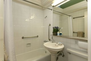 A full bathroom on the main living level is bright and functional.