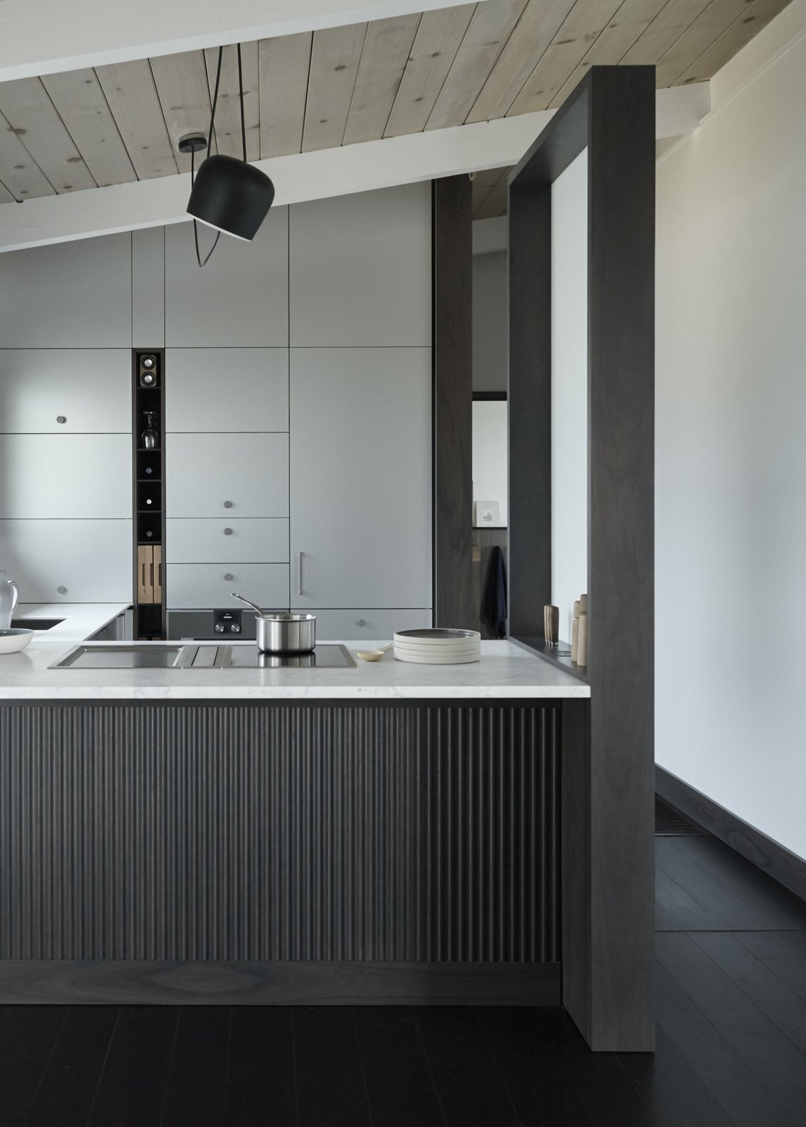 Kitchen, Cooktops, Wood Cabinet, and White Cabinet The Henrybuilt Functional Partition Wall can be freestanding, or attached to an island or peninsula.  Photo 7 of 10 in Henrybuilt's Systems Instantly Upgrade Unused Space