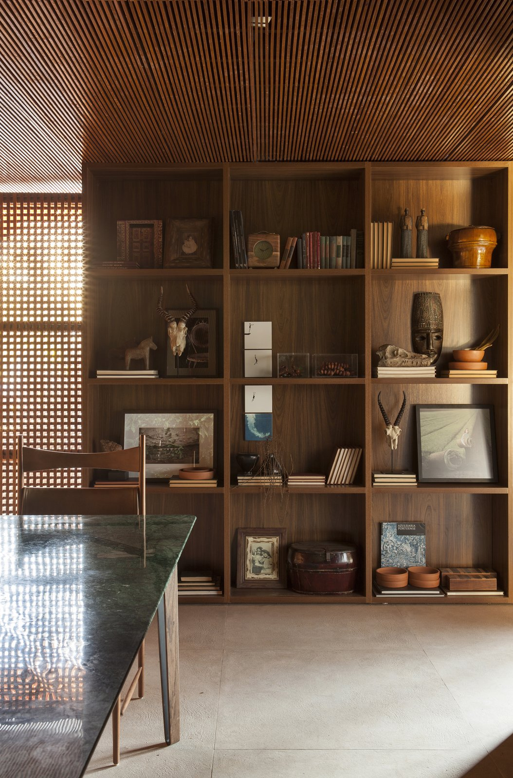 Storage Room and Shelves Storage Type Art, photographs, and sculpture are thoughtfully displayed.  Photo 6 of 14 in An Incredible Brazilian Home That Celebrates Art, Travel, and Nature