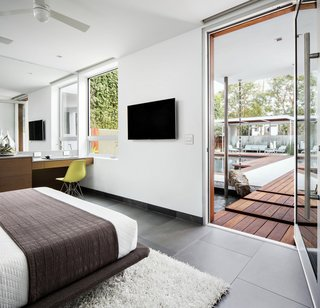 Western Window Systems Pivot Doors feature dual-paned low-E glass.