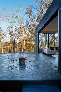 "In ARCHITECTUREFIRM's James River House, the 28-foot-long Series 600 Multi-Slide door is comprised of five 10-foot-tall panels of dual-paned, low-E glass, which helps keep the house warm during Virginia winters. All windows and doors feature thermally broken aluminum. ""Western Window Systems,"" says architect Danny MacNelly, ""does a great aluminum product that isn't very expensive. The details are minimal, clean, and refined."""