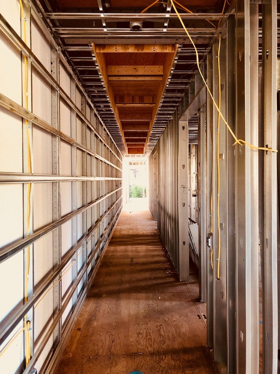 Hallway With the help of BONE Structure steel framework, electrical wires can be easily routed through pre-cut openings  Photo 7 of 7 in Dan Brunn Architecture and Dwell Break Ground on Bridge House in L.A.