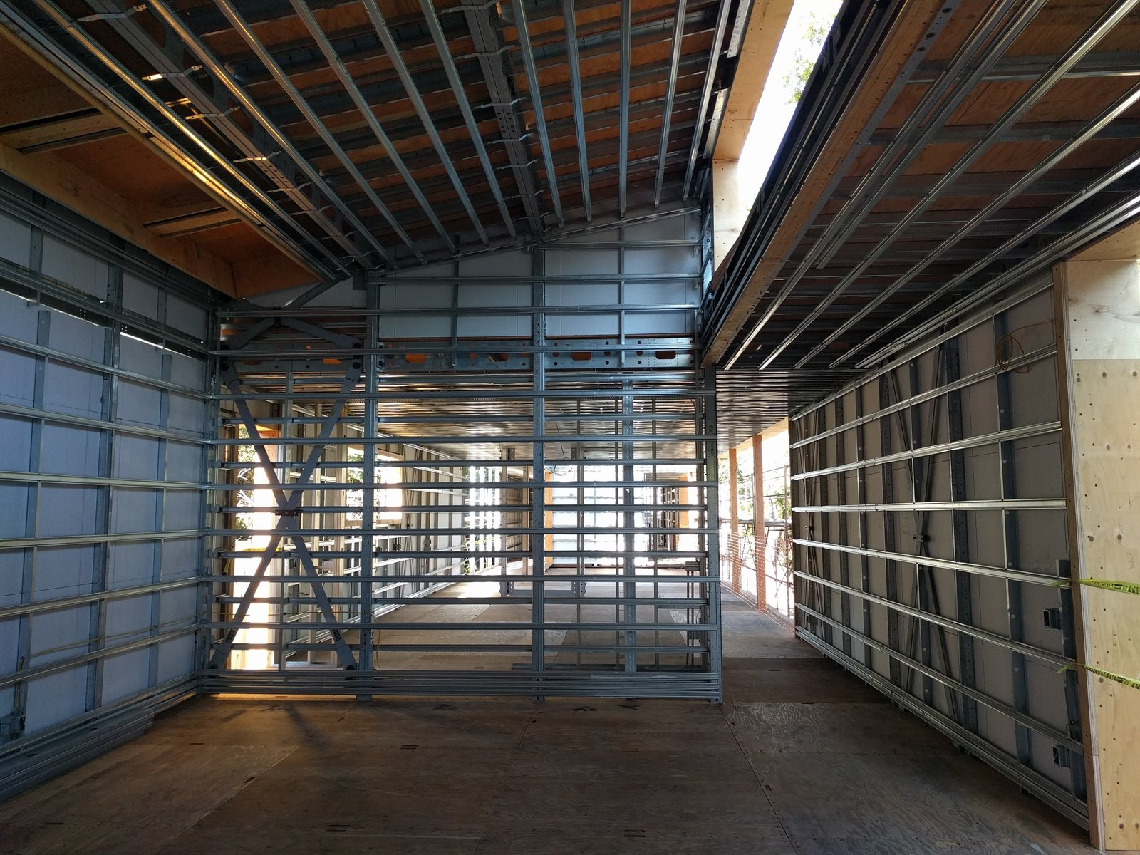 Hallway Using the BONE Structure system, no interior load bearing walls are required, offering complete freedom and customization inside.  Photo 6 of 7 in Dan Brunn Architecture and Dwell Break Ground on Bridge House in L.A.