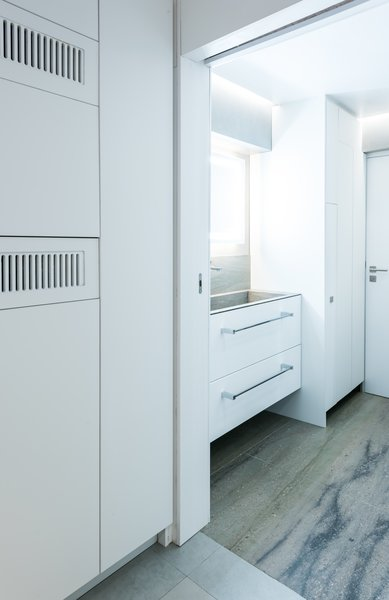 One of two bathrooms is tucked into the back corner of the home. The bathroom walls are among the only permanent walls in the entire apartment.