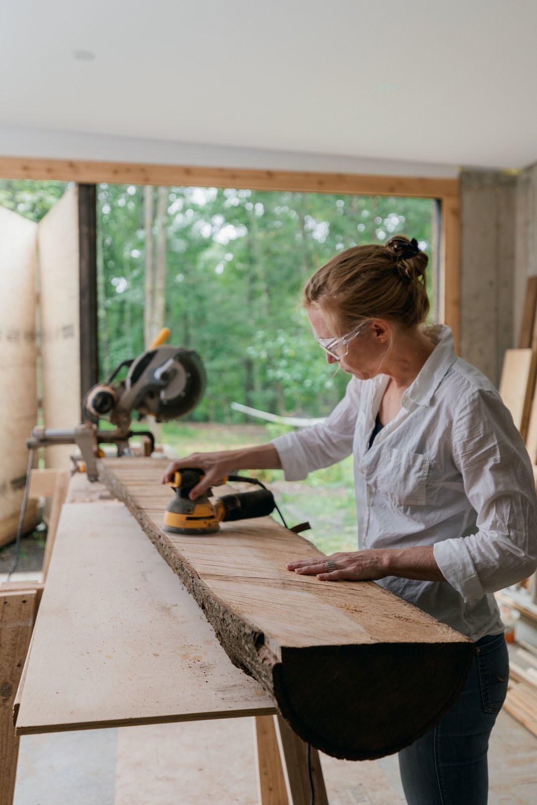 Garage The home's multifunctional layout gives Marica dedicated space for woodworking in her workshop, and Brock for tinkering with antique cars in the garage.  Photo 12 of 12 in A Couple's Scenic Getaway Built For Creating and Tinkering  in New York's Hudson Valley