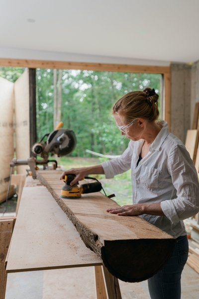 The home's multifunctional layout gives Marica dedicated space for woodworking in her workshop, and Brock for tinkering with antique cars in the garage.
