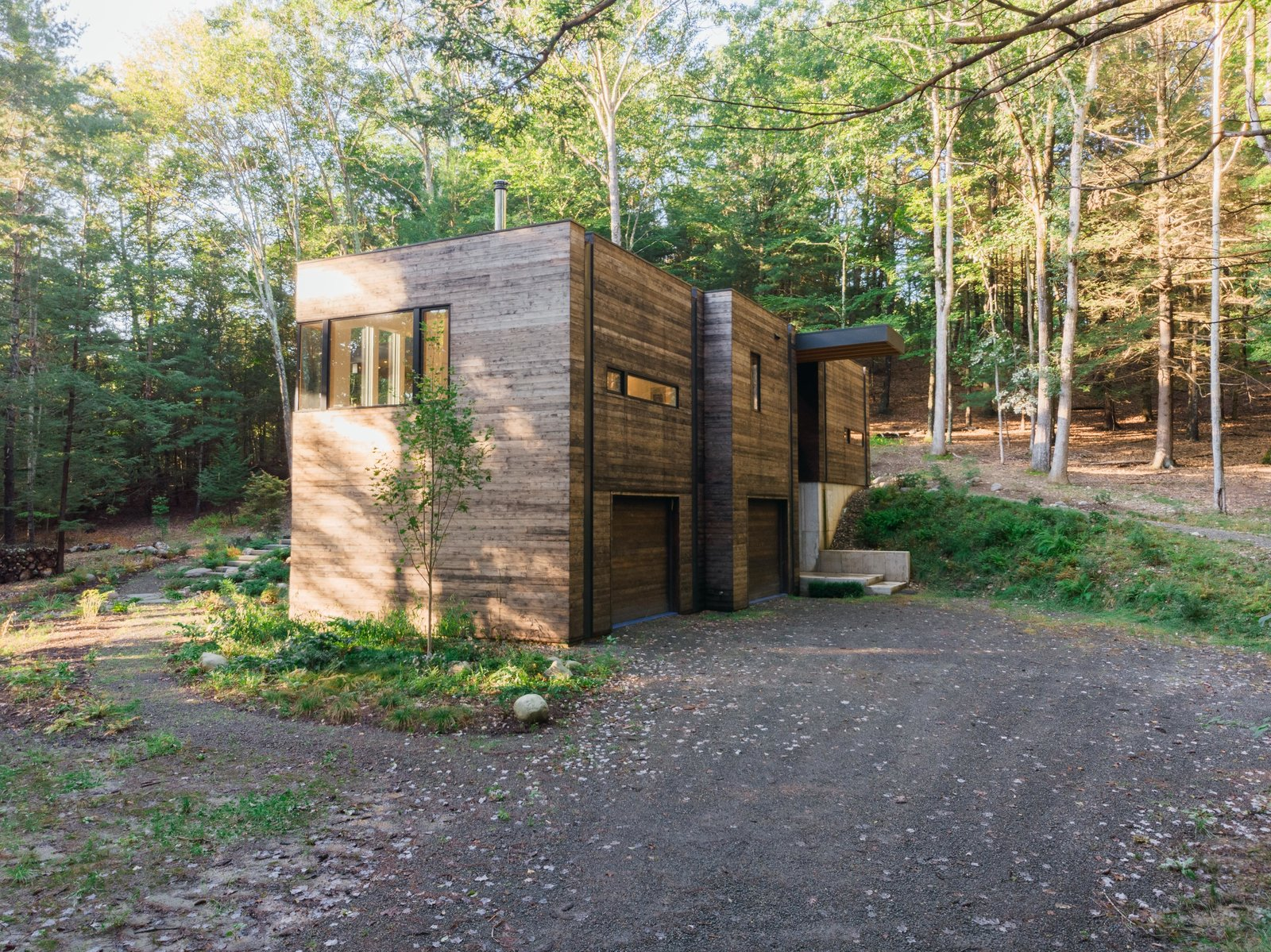 """Exterior, Wood Siding Material, Flat RoofLine, and House Building Type The home """"is really about place, how it sits on the site, how it responds to the sun,"""" reflects McKeel.  Photo 4 of 12 in A Couple's Scenic Getaway Built For Creating and Tinkering  in New York's Hudson Valley"""