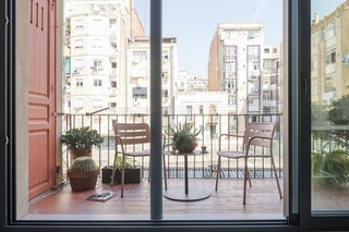 "The view from the kitchen to the newly opened terrace is one of Serboli's favorite parts of the home. ""I love being in the kitchen, looking at the living room with the big window totally open. I think it's a privileged position because you can cook or eat (I love both) looking towards a space with unclear and undefined limits."""