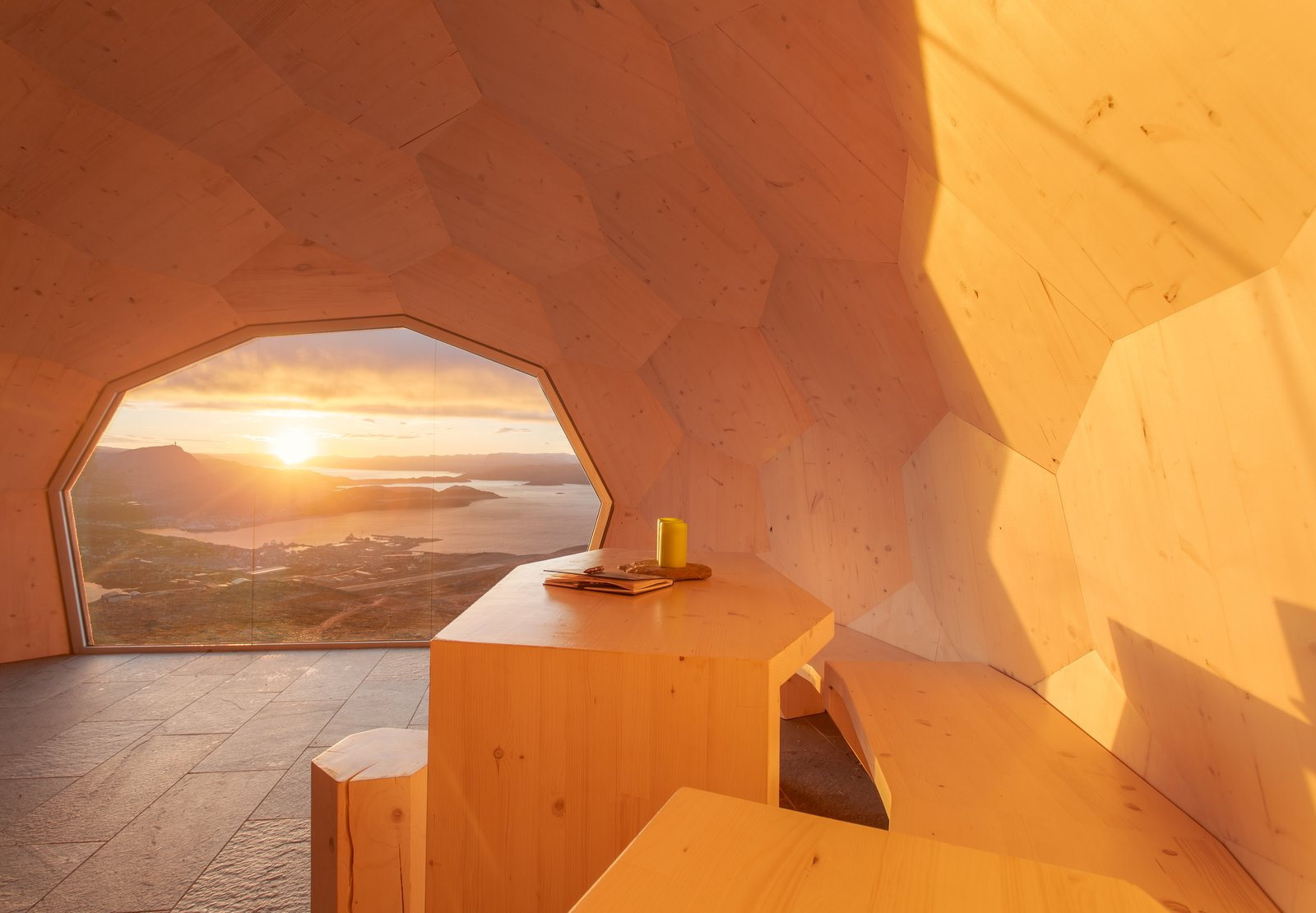Hammerfest Cabin interior with sunset view