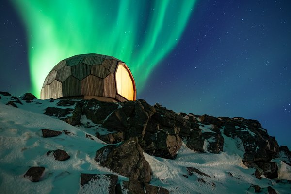 The Hammerfest Cabin is perched high atop a rocky slope.