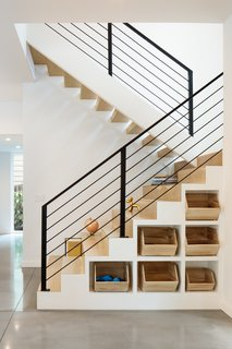 "Clever cubby storage is incorporated into the base of the interior stairs, while the extra-deep stair treads provide flexible ""stadium-style"" seating for the kids."
