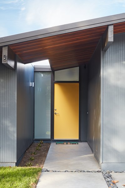 """Klopf Architecture preserved the vertical """"thinline"""" wood siding, and matched it in kind at the front addition."""