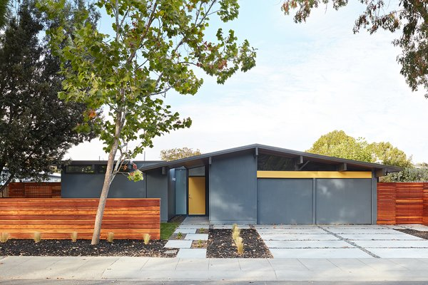 Klopf Architecture's modest 72-square-foot addition at the front of the home blends in with the original structure while giving the owners a greater sense of openness in the master and hall bathrooms. Inside, the re-imagined great room now features dining space.