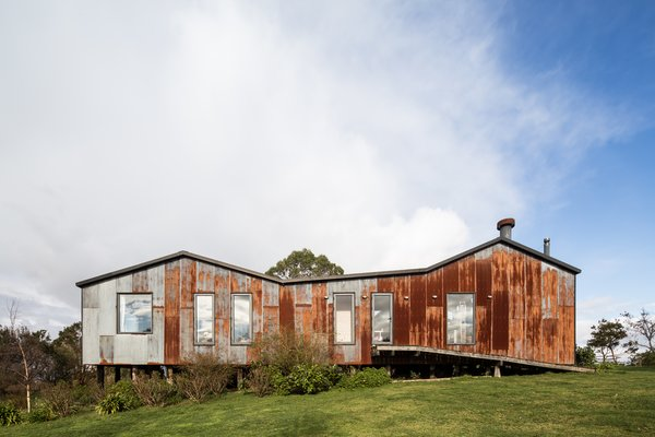 """""""The materiality and the look of the house had to have the identity of Chiloé,"""" says Sánchez. Corrugated zinc panels clad the home's exterior, zinc being the chosen material which """"covers 90% of the houses in Southern Chile."""""""