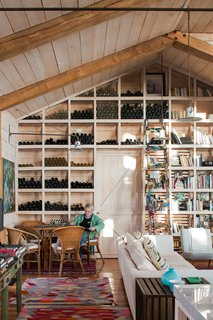 """From the start, the clients wanted their home to have a """"barn look,"""" honoring the agrarian vernacular of the built environment around them. Interior walls and ceilings are clad in local pine, with a paint treatment to remove the yellow from the wood."""