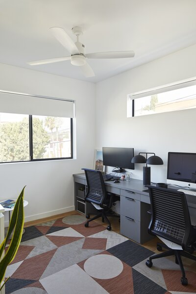 A key pandemic-inspired addition, a gracious home office, was incorporated into the second bedroom, allowing this wing of the home to be activated as a workspace when not being utilized as a guest suite.