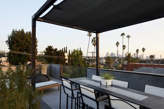 """The view,"" recalls Todd, ""was a driving factor in purchasing this lot."" Designed with outdoor living in mind, the roof deck includes ample space for al fresco dining, lounging, and soaking in the Southern California sunshine."