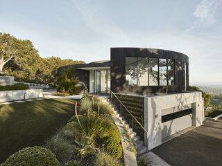 A Bold Circular Home Radiates Outward From Its Futuristic Kitchen