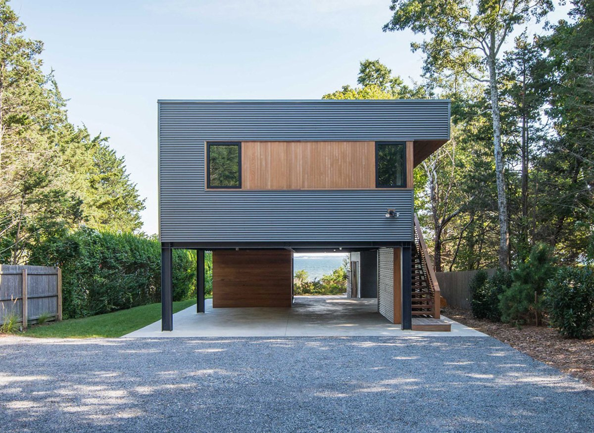 Exterior, Flat RoofLine, House Building Type, and Prefab Building Type Approach via long gravel driveway; Great Peconic Bay seen beyond  Photo 11 of 14 in 7 Efficient Prefabs That Prove the Power of Modular Design