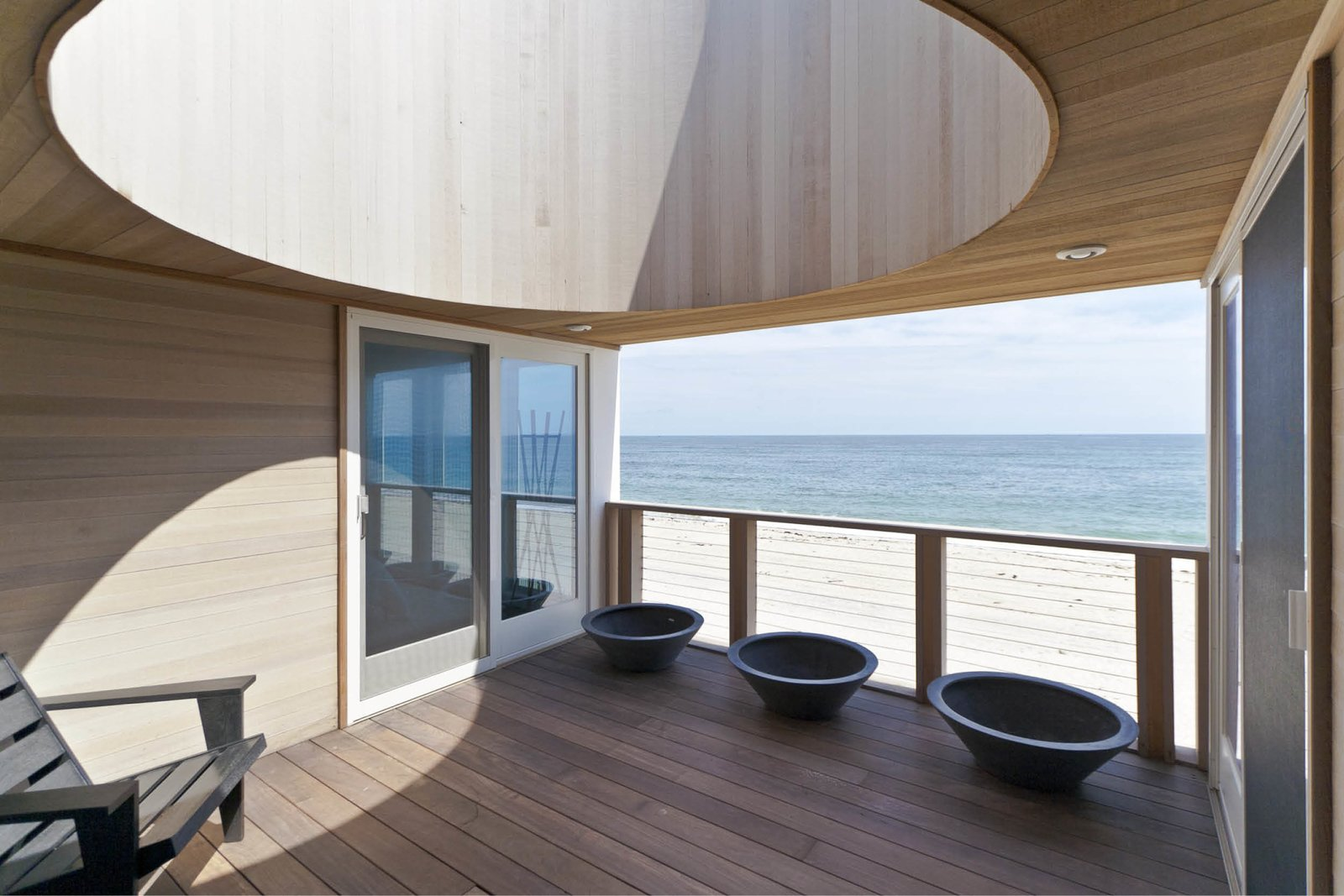 Wood, House, Wood, and Outdoor The oculus deck serves as an oversized sun dial  Outdoor Wood House Photos from Dune Road Beach House