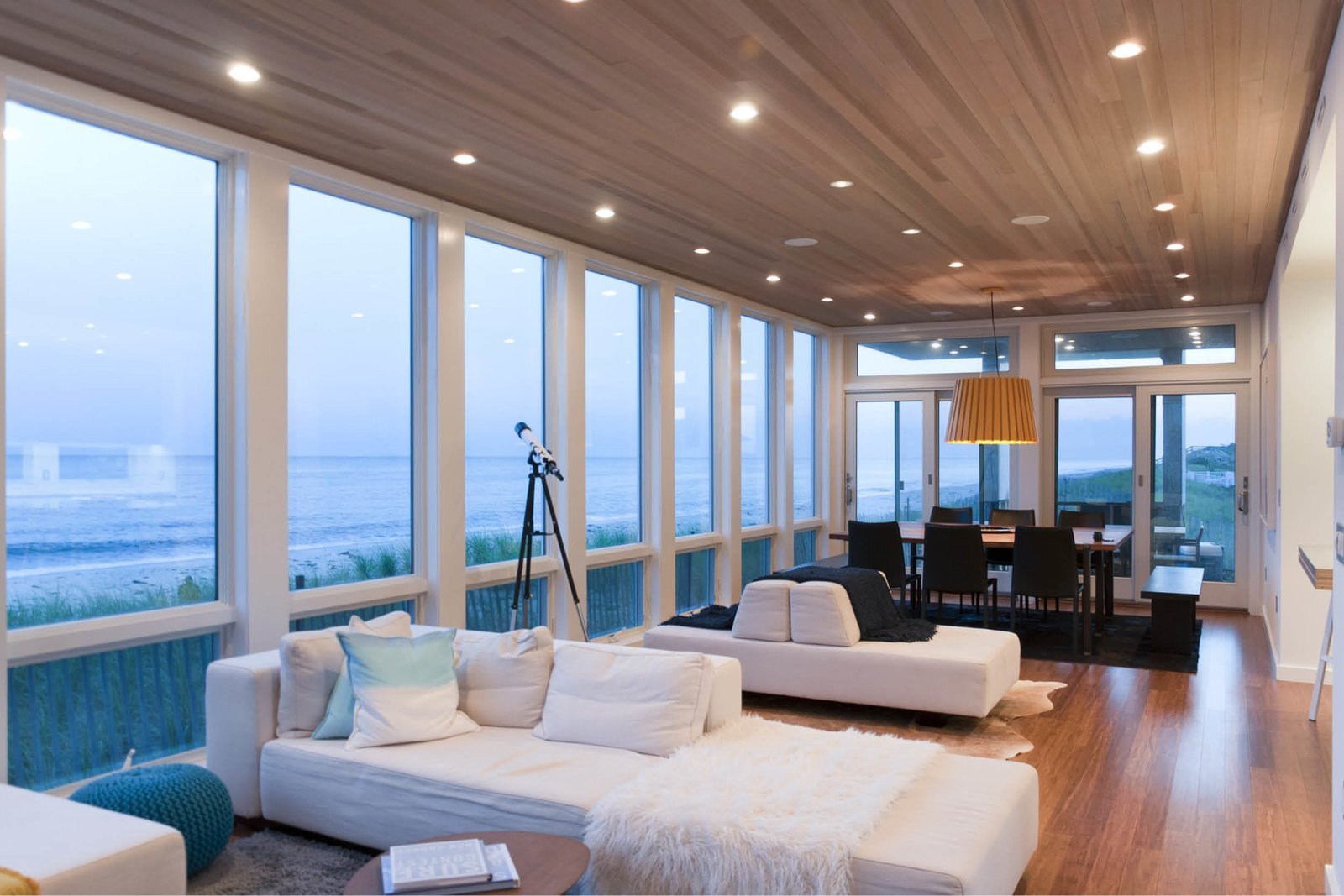 Sofa, Ceiling Lighting, Medium Hardwood Floor, and Outdoor Communal space with expansive views of the ocean  Dune Road Beach House by Resolution: 4 Architecture