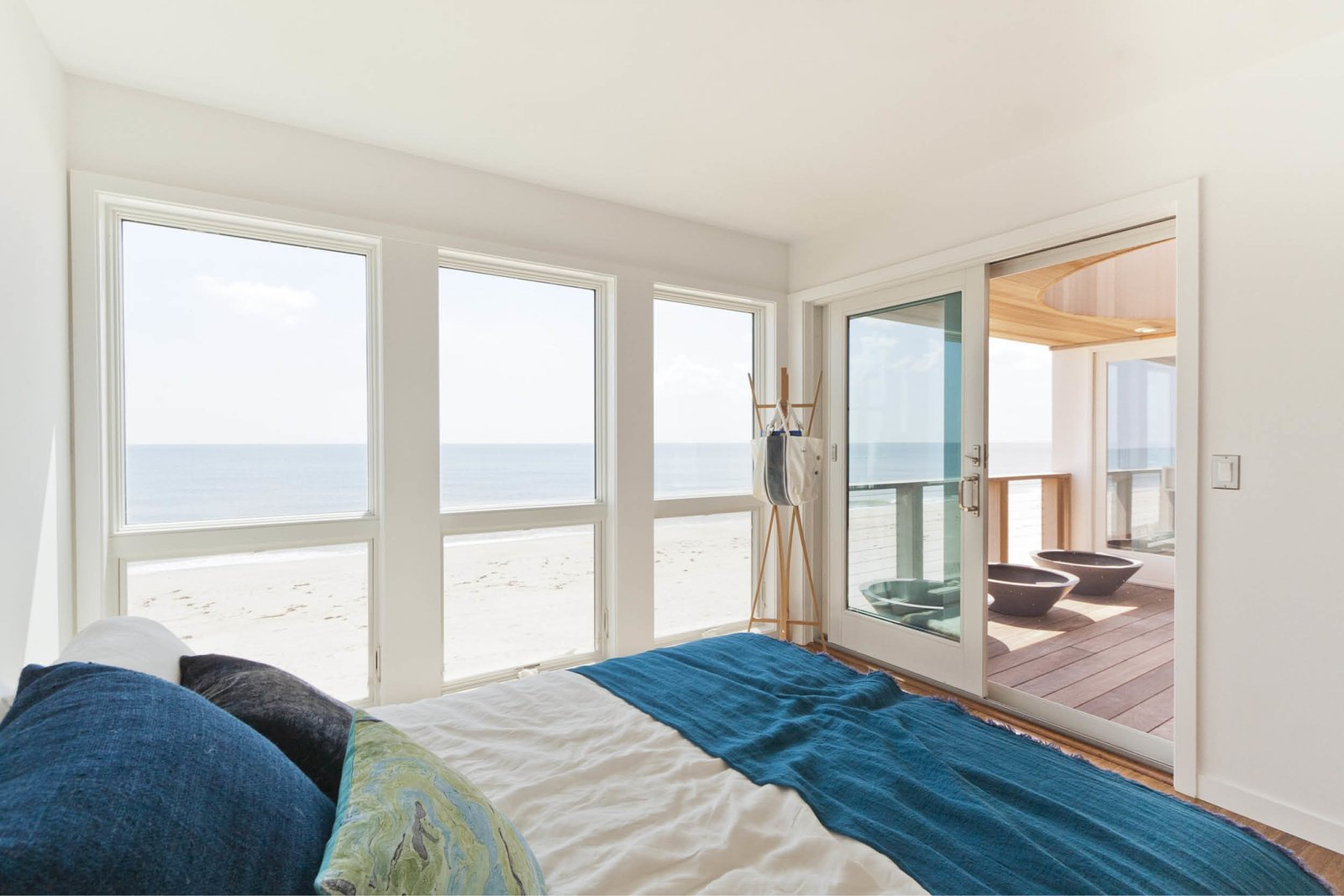 Bedroom, Medium Hardwood Floor, and Bed Guest bedroom  Dune Road Beach House by Resolution: 4 Architecture