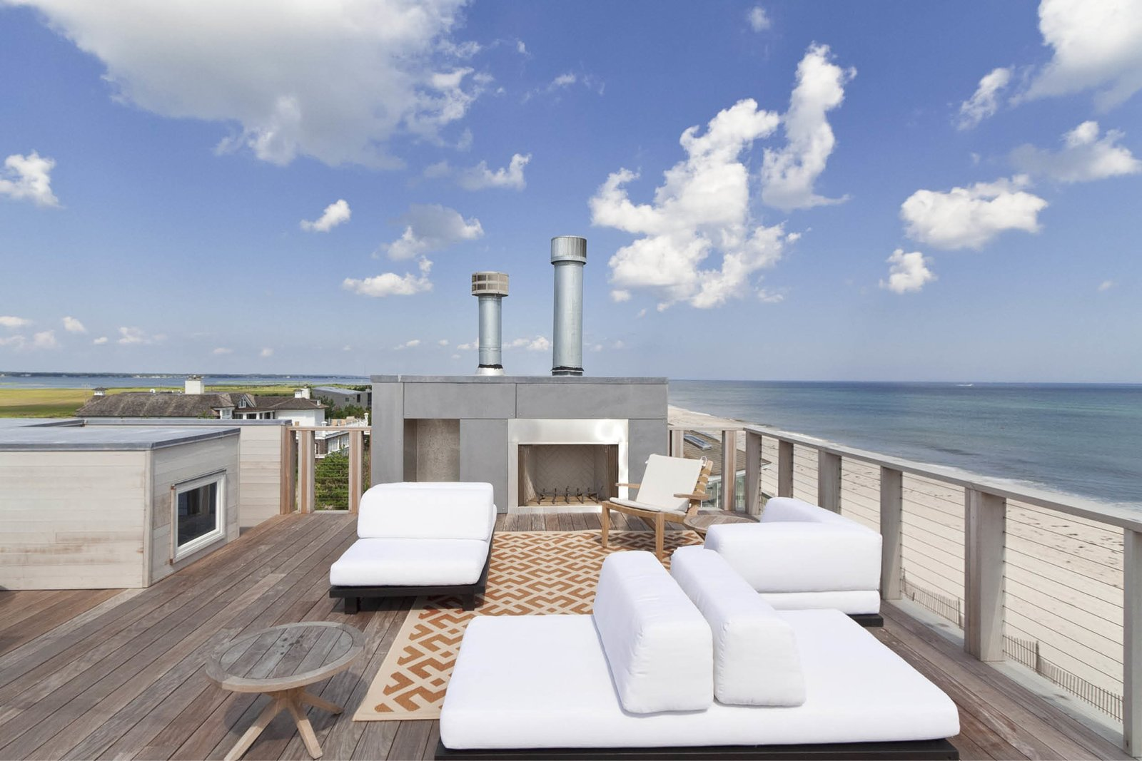 Rooftop, Wire Fences, Wall, Wood Patio, Porch, Deck, Decking Patio, Porch, Deck, Horizontal Fences, Wall, Wood Fences, Wall, and Exterior Roof deck/Outdoor living space  Best Photos from Dune Road Beach House