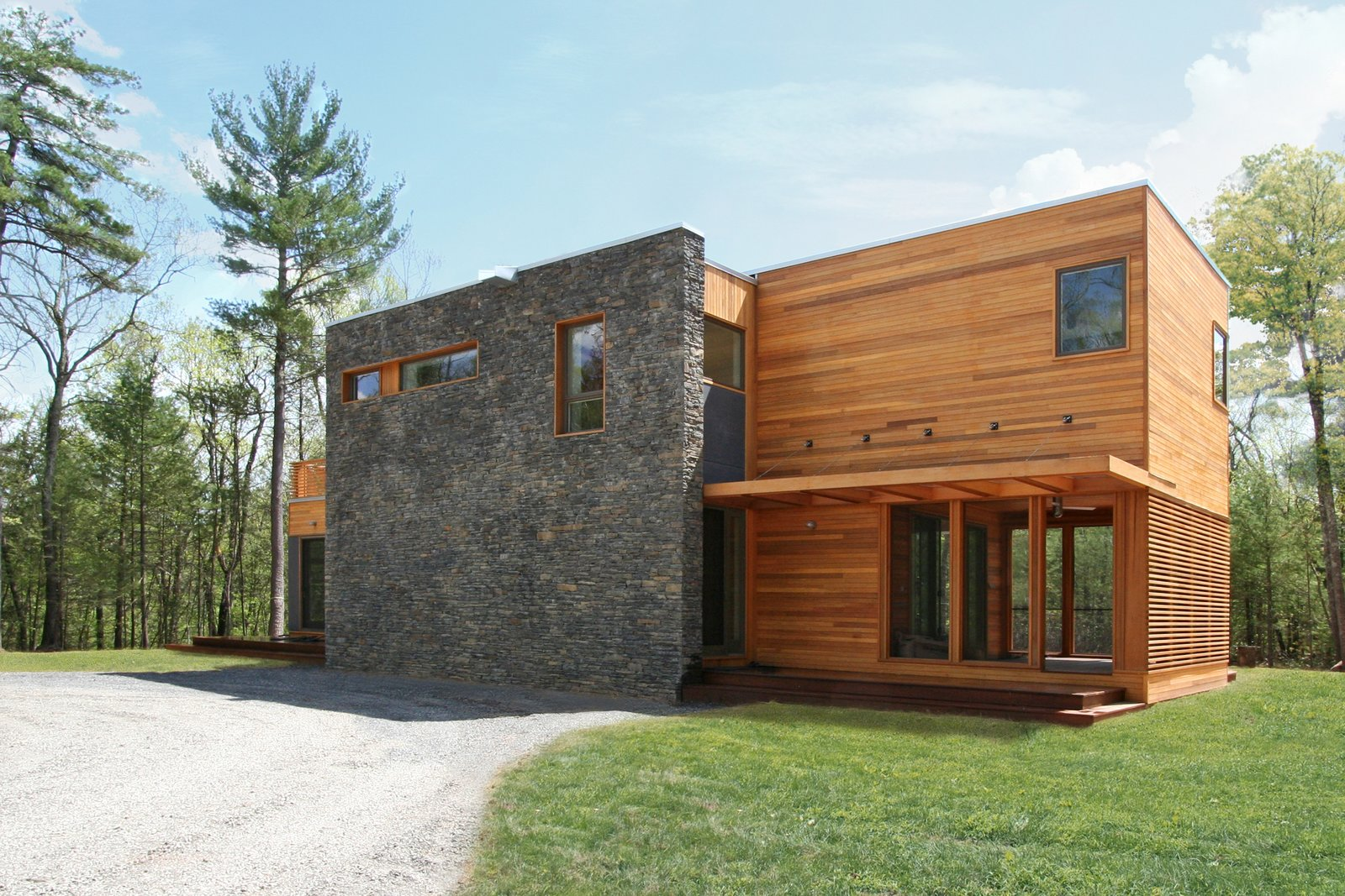 Exterior, House Building Type, Wood Siding Material, Flat RoofLine, Prefab Building Type, and Stone Siding Material Entry court  Photo 13 of 14 in 7 Efficient Prefabs That Prove the Power of Modular Design