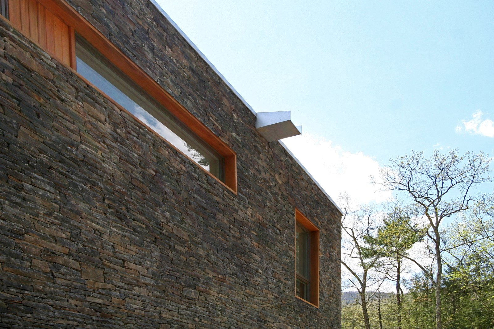 Stacked stone wall, cedar window trim, and custom overflow scupper  Catskills Suburban by Resolution: 4 Architecture