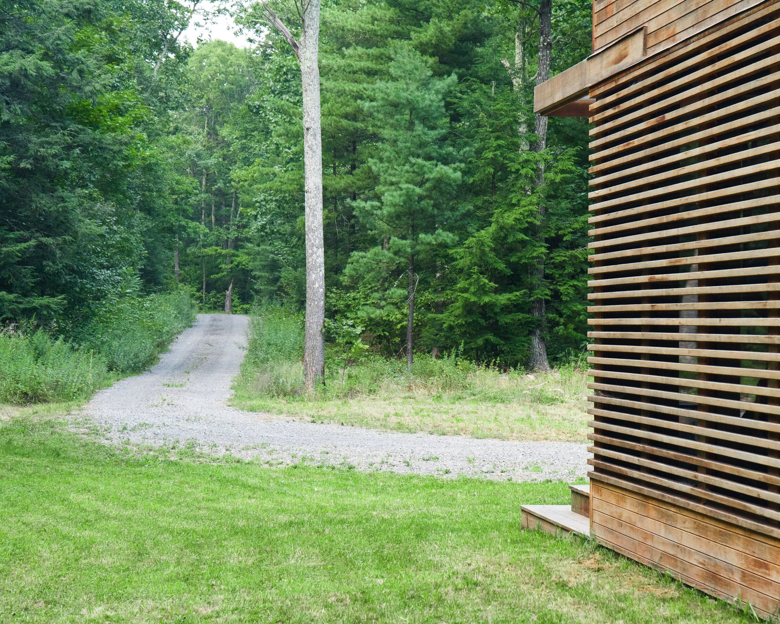 The home is accessed via a long gravel drive through the woods  Catskills Suburban by Resolution: 4 Architecture