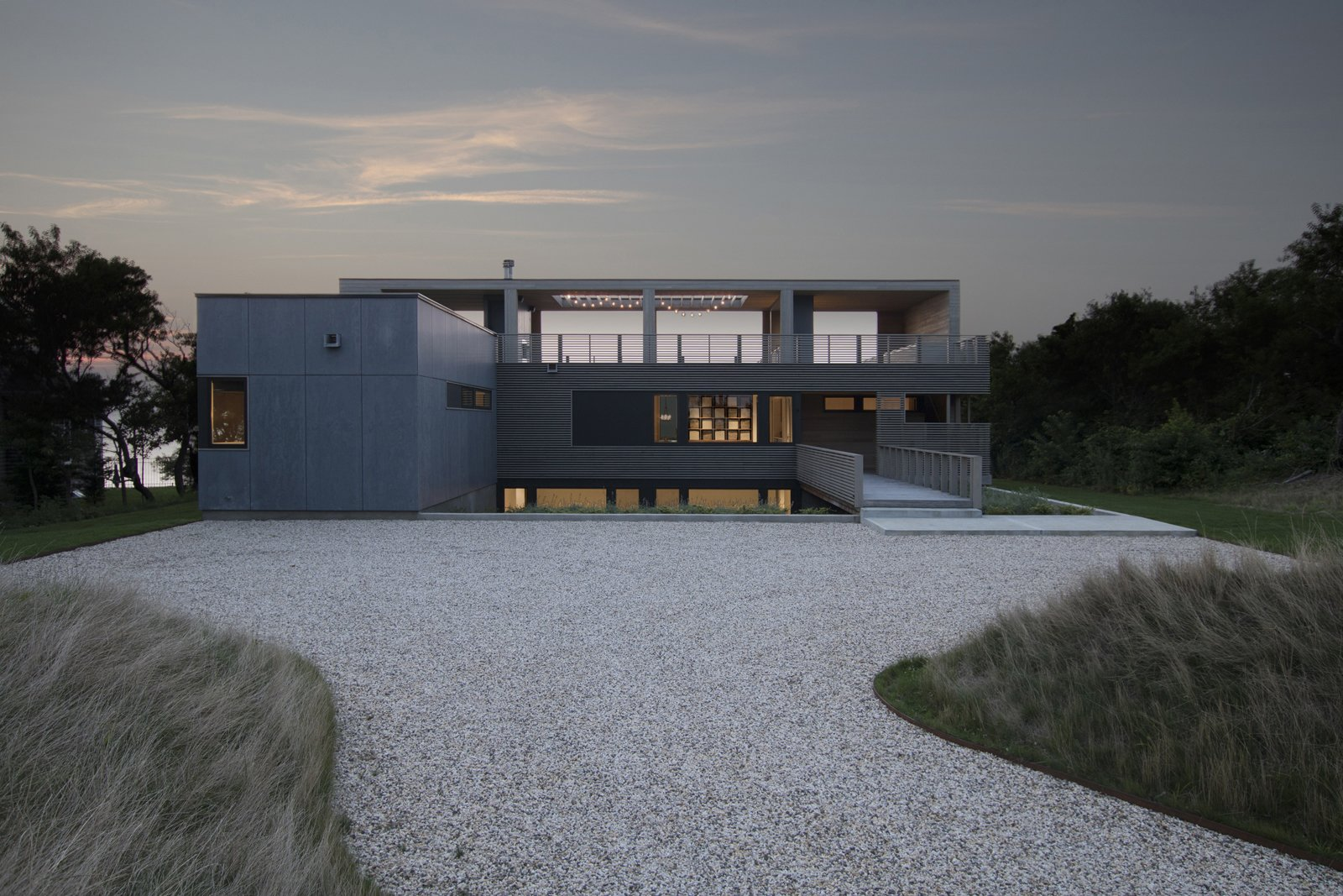 Exterior, Wood Siding Material, House Building Type, Flat RoofLine, and Prefab Building Type Front of the home at dusk  North Fork Bluff House by Resolution: 4 Architecture