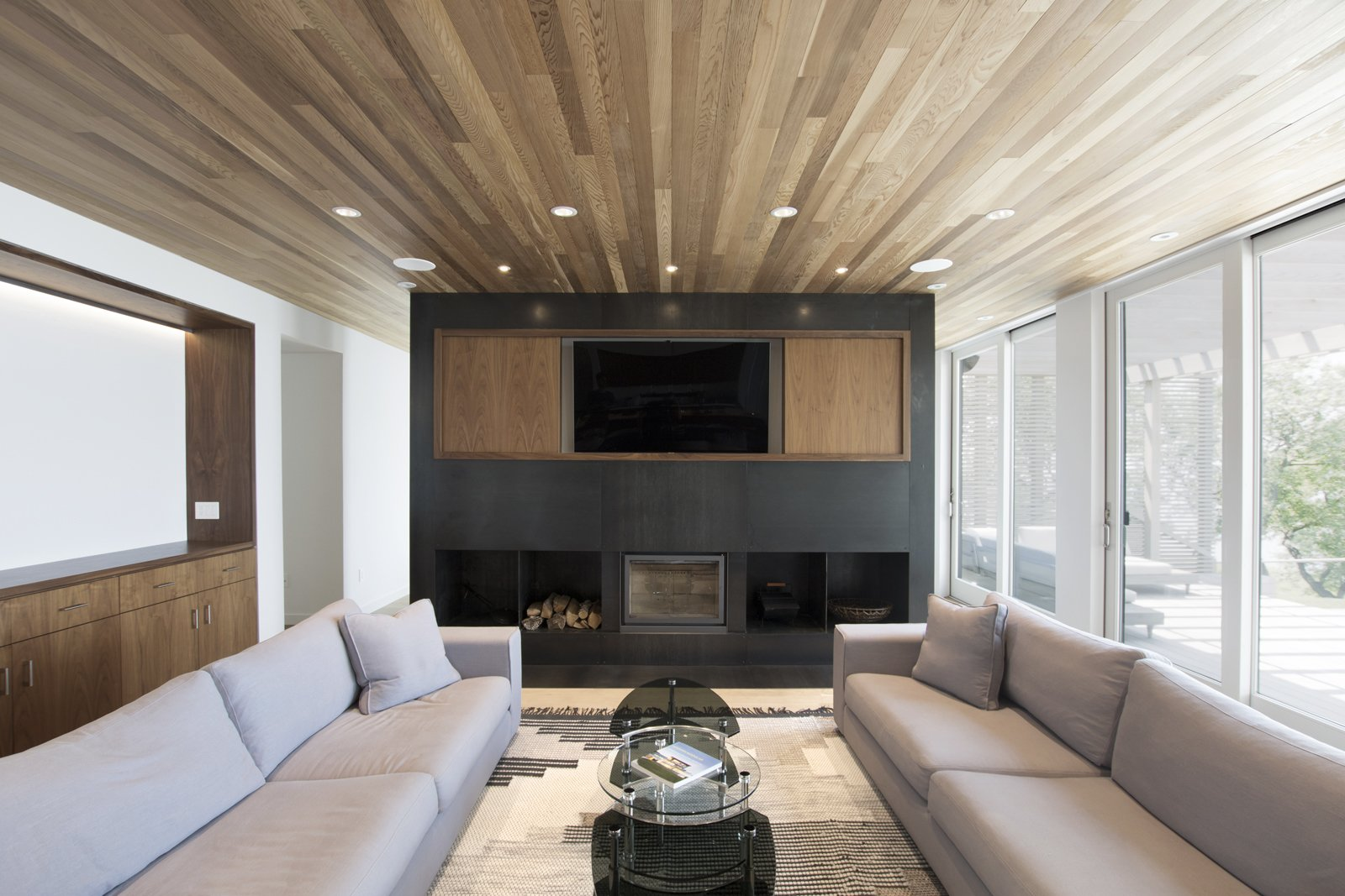 Living Room, Sofa, Light Hardwood Floor, Wood Burning Fireplace, Ceiling Lighting, and Standard Layout Fireplace Living room  North Fork Bluff House by Resolution: 4 Architecture