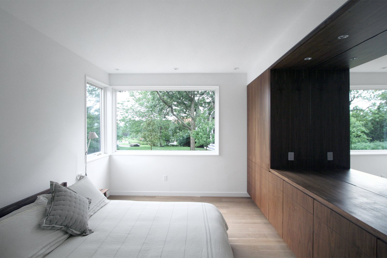 Bedroom, Bed, Dresser, Light Hardwood Floor, Night Stands, Ceiling Lighting, and Wardrobe Bedroom at front of home   North Fork Bluff House by Resolution: 4 Architecture